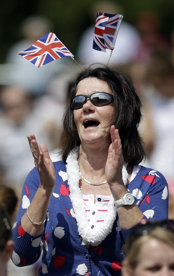 Christine Steel attends a performance by the Pet Shop Boys before the start of tennis competition at the All England Lawn Tennis Club at Wimbledon, in London, at the 2012 Summer Olympics, Saturday, July 28, 2012. (AP Photo/Mark Humphrey)