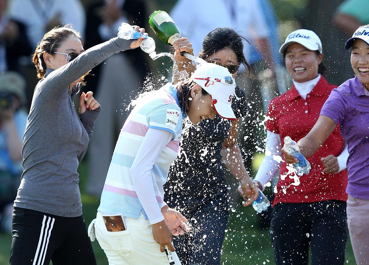 KOHLER, WI - JULY 08:  Na Yeon Choi of South Korea is sprayed with champagne by players and friends after her four-stroke victory at the 2012 U.S. Women's Open on July 8, 2012 at Blackwolf Run in Kohler, Wisconsin.  (Photo by Scott Halleran/Getty Images)