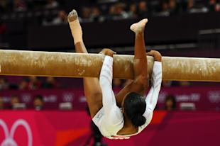 Gabrielle Douglas falls off the beam during the Artistic Gymnastics Women's Beam final. (Getty Images)