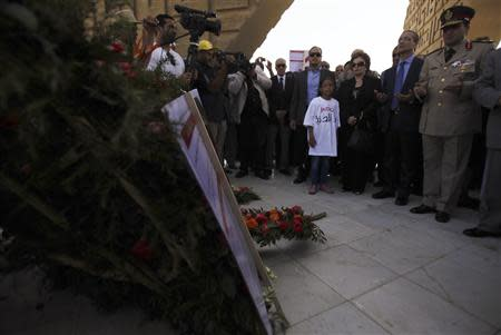 Jehan Sadat, the widow of late President Anwar Sadat (3rd R), and his son Gamal al-Sadat (2nd R) pay their respects at Sadat's tomb during the 40th anniversary of Egypt's attack on Israeli forces during the 1973 war, at Cairo's Nasr City district, October 6, 2013. REUTERS/Amr Abdallah Dalsh