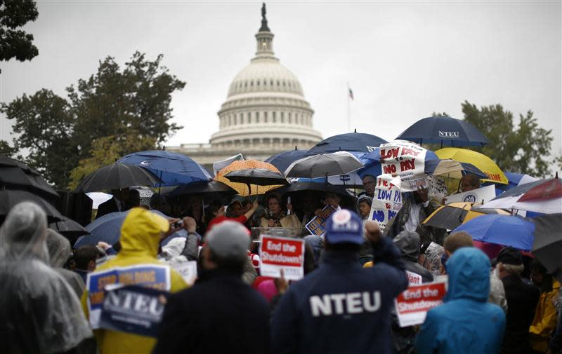 U.S. House Minority Leader Nancy Pelosi addresses protesters calling for an end to the U.S. government shut down on Capitol Hill in Washington