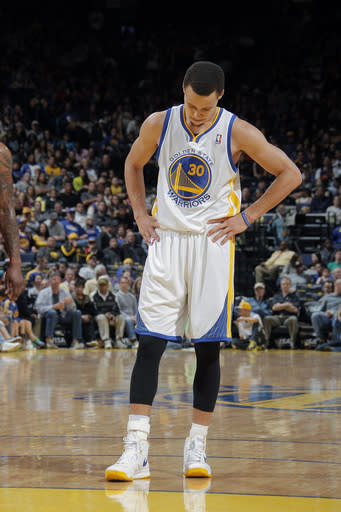 Curry's 35 lift Warriors past Wizards, 101-92