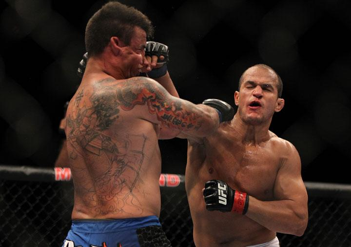 LAS VEGAS, NV - MAY 26:  (R-L) Junior dos Santos punches Frank Mir during the Heavyweight Championship bout at UFC 146 at MGM Grand Garden Arena on May 26, 2012 in Las Vegas, Nevada.
