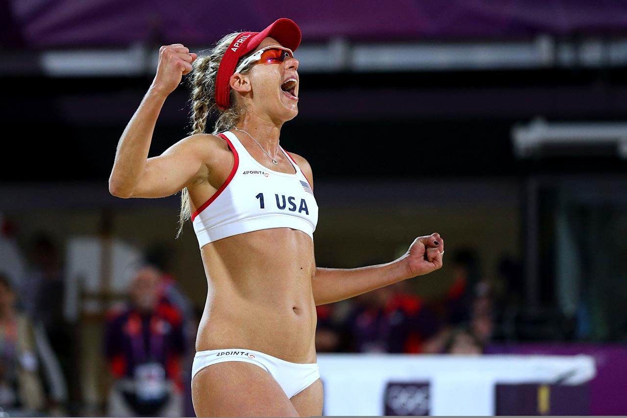 LONDON, ENGLAND - AUGUST 08:  April Ross of the United States celebrates a point during the Women's Beach Volleyball Gold medal match on Day 12 of the London 2012 Olympic Games at the Horse Guard's Parade on August 8, 2012 in London, England.  (Photo by Cameron Spencer/Getty Images)