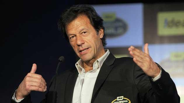 Former Pakistan captain Imran Khan gestures during a promotional function of a telecom company in Mumbai on February 2, 2011.