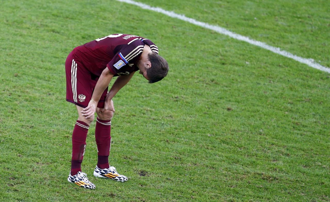 Russia's Denis Glushakov shows dejection after the 2014 World Cup Group H soccer match between Algeria and Russia at the Baixada arena in Curitiba June 26, 2014. REUTERS/Amr Abdallah Dalsh (BRAZIL - Tags: SOCCER SPORT WORLD CUP)