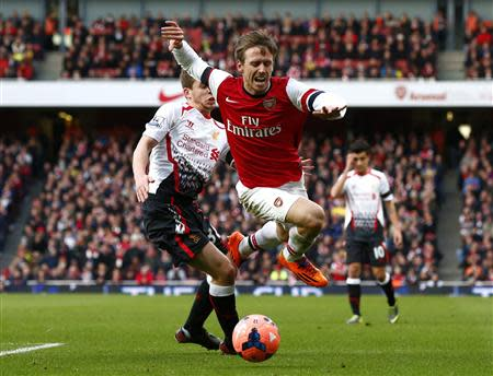 Arsenal's Monreal is fouled by Liverpool's Flanagan during their English FA Cup fifth round soccer match in London