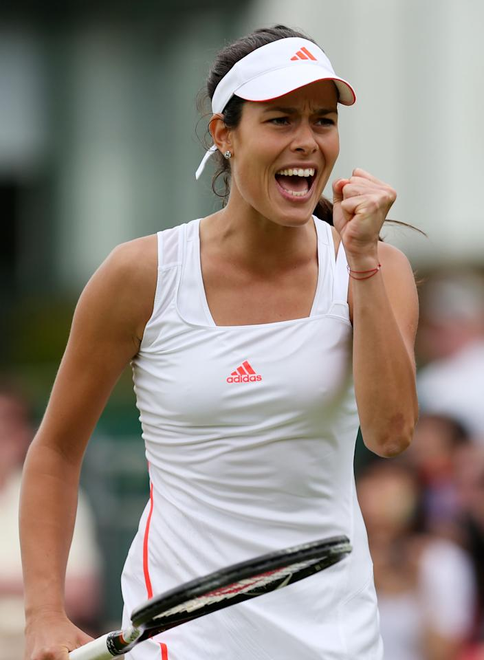 LONDON, ENGLAND - JUNE 27:  Ana Ivanovic of Serbia celebrates match point during her ladies singles first round match against Maria Jose Martinez Sanchez of Spain on day three of the Wimbledon Lawn Tennis Championships at the All England Lawn Tennis and Croquet Club on June 27, 2012 in London, England.  (Photo by Clive Rose/Getty Images)