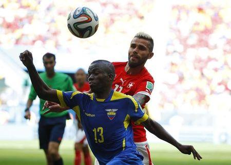 Ecuador's Valencia fights for the ball with Switzerland's Behrami during their 2014 World Cup Group E soccer match at the Brasilia national stadium in Brasilia
