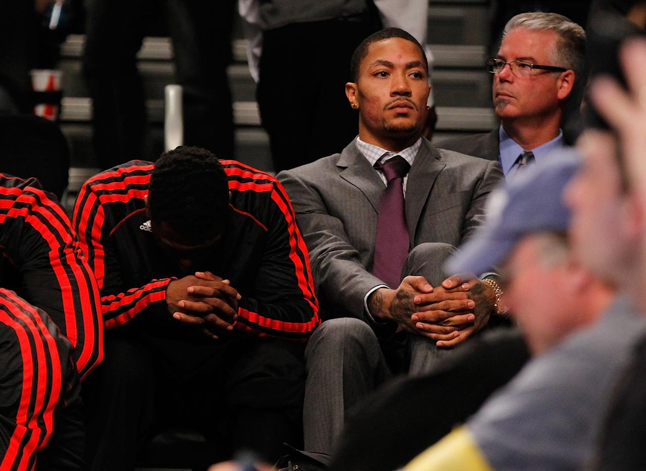 NEW YORK, NY - APRIL 20:   Derrick Rose #1 of the Chicago Bulls looks on from the bench against the Brooklyn Nets during Game One of the Eastern Conference Quarterfinals of the 2013 NBA Playoffs at Barclays Center on April 20, 2013 in New York City. NOTE TO USER: User expressly acknowledges and agrees that, by downloading and or using this photograph, User is consenting to the terms and conditions of the Getty Images License Agreement. Nets defeated the Bulls 106-89.  (Photo by Mike Stobe/Getty Images)
