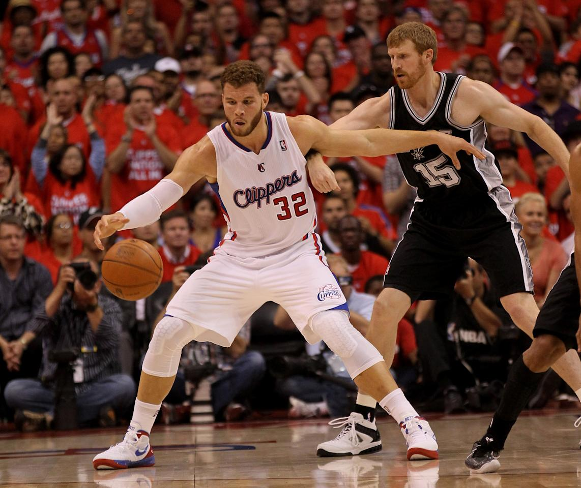 Blake Griffin #32 of the Los Angeles Clippers catches a pass in front of Matt Bonner #15 of the San Antonio Spurs in Game Three of the Western Conference Semifinals in the 2012 NBA Playoffs on May 19, 2011 at Staples Center in Los Angeles, California.  NOTE TO USER: User expressly acknowledges and agrees that, by downloading and or using this photograph, User is consenting to the terms and conditions of the Getty Images License Agreement.  (Photo by Stephen Dunn/Getty Images)