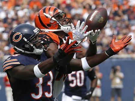 Cincinnati Bengals' Andrew Hawkins makes a catch against Chicago Bears' Charles Tillman during the first quarter of their NFL football game in Chicago, Illinois