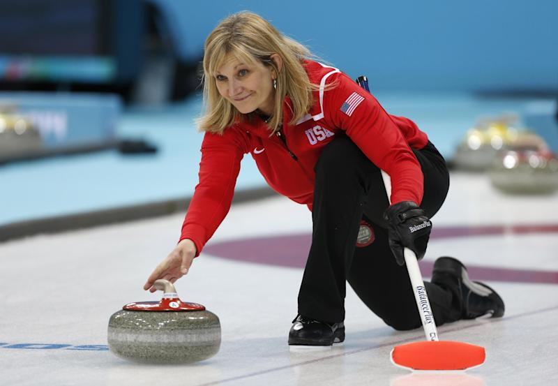 Erika Brown, skip of Team USA, delivers the stone during a women's curling training session at the 2014 Winter Olympics, Sunday, Feb. 9, 2014, in Sochi, Russia