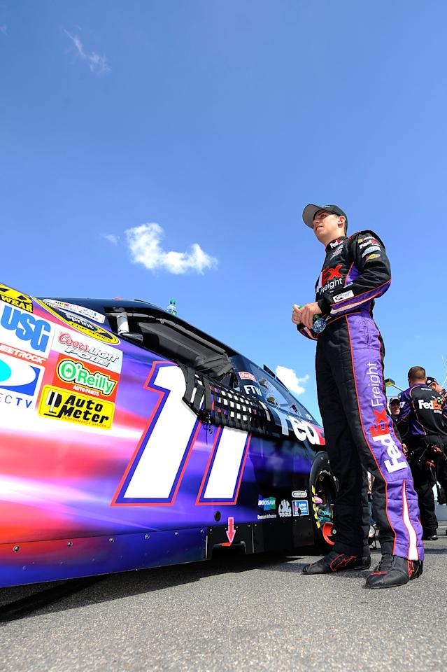 KANSAS CITY, KS - OCTOBER 09:  Denny Hamlin, driver of the #11 FedEx Freight Toyota, stands on the grid prior to the start of the NASCAR Sprint Cup Series Hollywood Casino 400 at Kansas Speedway on October 9, 2011 in Kansas City, Kansas.  (Photo by Jason Smith/Getty Images for NASCAR)