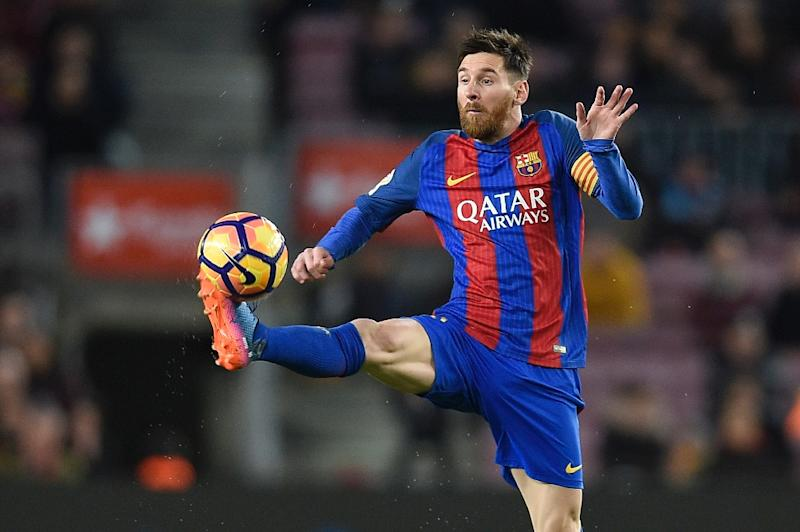 Barcelona's Lionel Messi controls the ball during the Spanish league match against Sporting Gijon