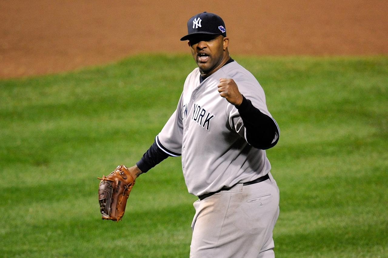 BALTIMORE, MD - OCTOBER 07:  CC Sabathia #52 of the New York Yankees reacts after Mark Reynolds #12 of the Baltimore Orioles grounded out for the final out in the bottom of the eighth inning during Game One of the American League Division Series at Oriole Park at Camden Yards on October 7, 2012 in Baltimore, Maryland.  (Photo by Patrick McDermott/Getty Images)