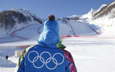 A volunteer looks up to the start of the downhill courses at the Rosa Khutor Alpine Skiing mountain resort ahead of the Sochi 2014 Winter Olympic Games
