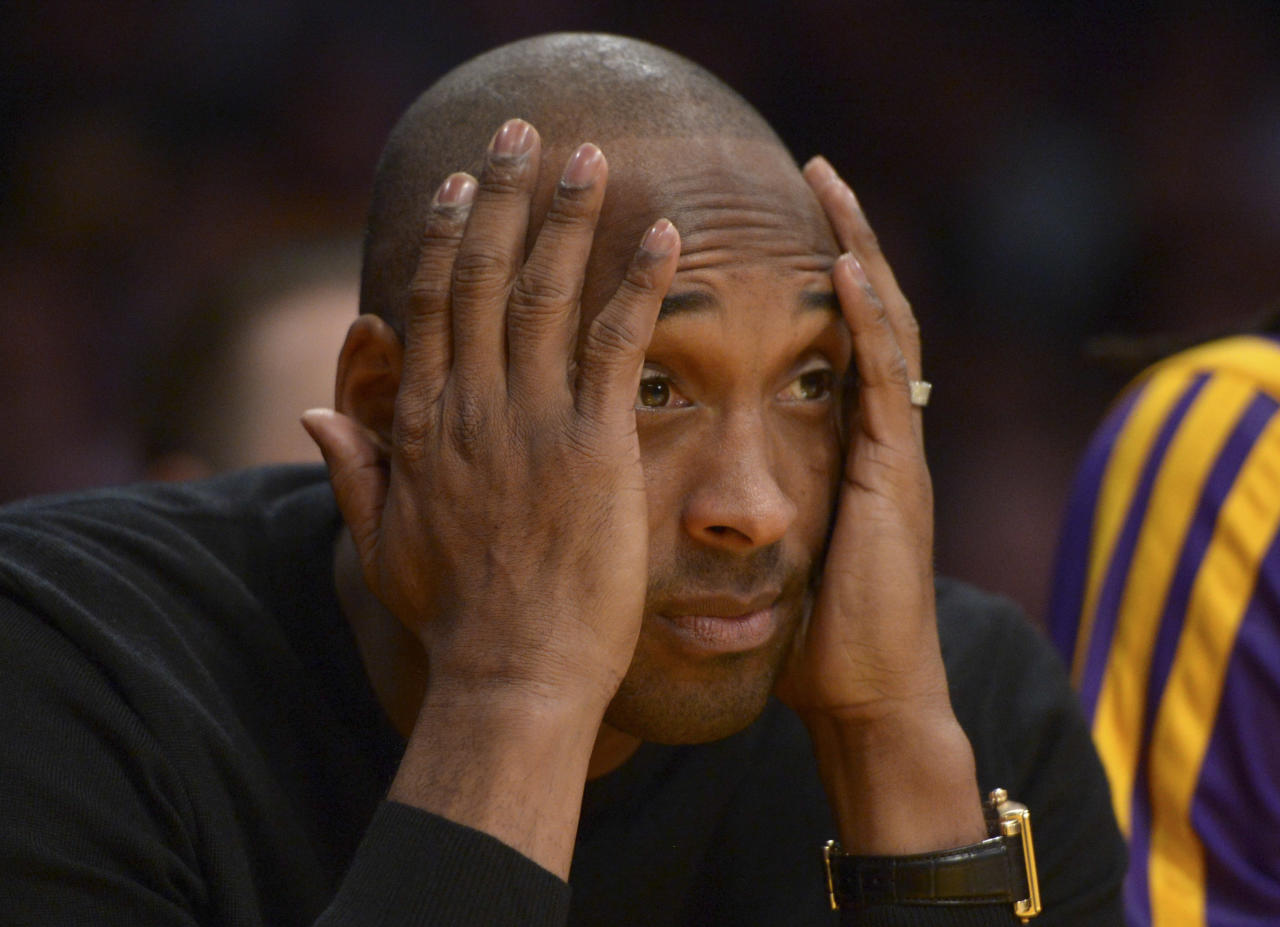 Dec 31, 2013; Los Angeles, CA, USA; Los Angeles Lakers guard Kobe Bryant (24) reacts in the fourth quarter against the Milwaukee Bucks at Staples Center. The Bucks defeated the Lakers 94-79. (Kirby Lee-USA TODAY Sports)