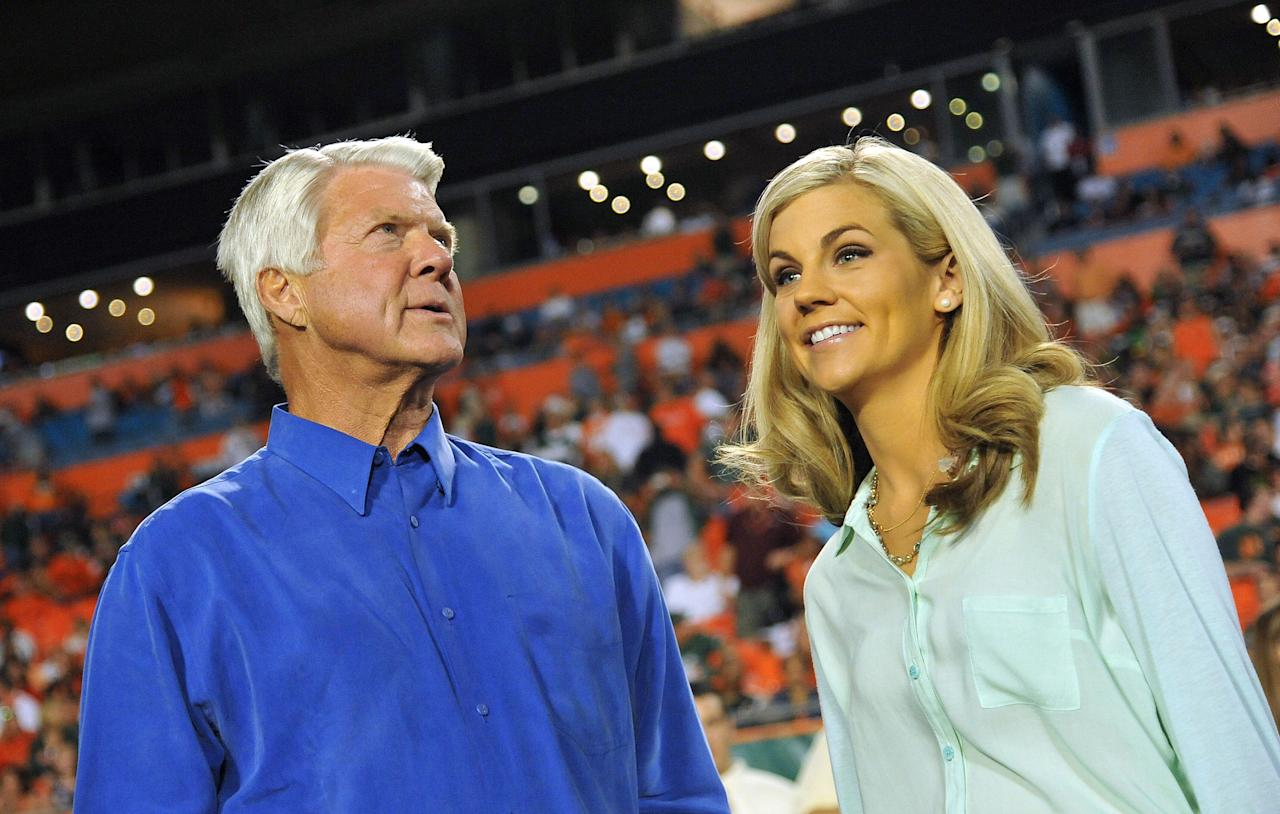 Sideline reporter Samantha Steele (right) is seen talking with former Miami Hurricanes head coach Jimmy Johnson (left) during a game.
