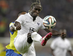 France's Bacary Sagna clears the ball ahead of Ecuador's Alex Ibarra during the group E World Cup soccer match. (AP)