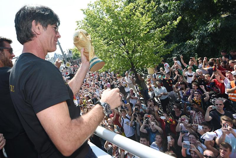 Germany's coach Joachim Loew celebrates during a victory parade of Germany's football national team on July 15, 2014 at Berlin's landmark Brandenburg Gate