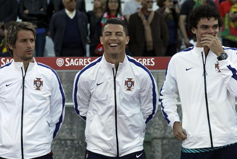 Portugal's Cristiano Ronaldo, centre, laughs with teammates Fabio Coentrao, left, and Pepe prior a friendly soccer match between Portugal and Greece at the National stadium, in Oeiras, near Lisbon, Saturday, May 31, 2014. The game was a warm-up match for both teams ahead the World Cup in Brazil. The match ended in a 0-0 draw