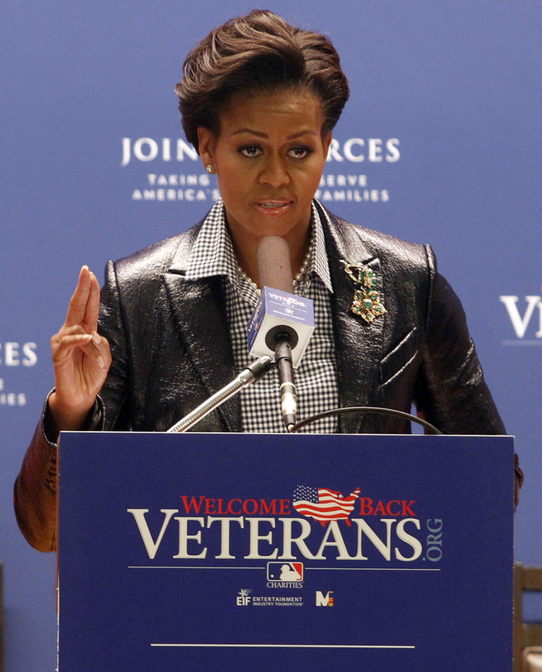 U.S. first lady Michelle Obama speaks at an event recognizing Major  League Baseball's (MLB) outstanding support of America's veterans and  military families as part of their Joining Forces initiative in St.  Louis October 19, 2011. <br><br>(REUTERS/Sarah Conard)