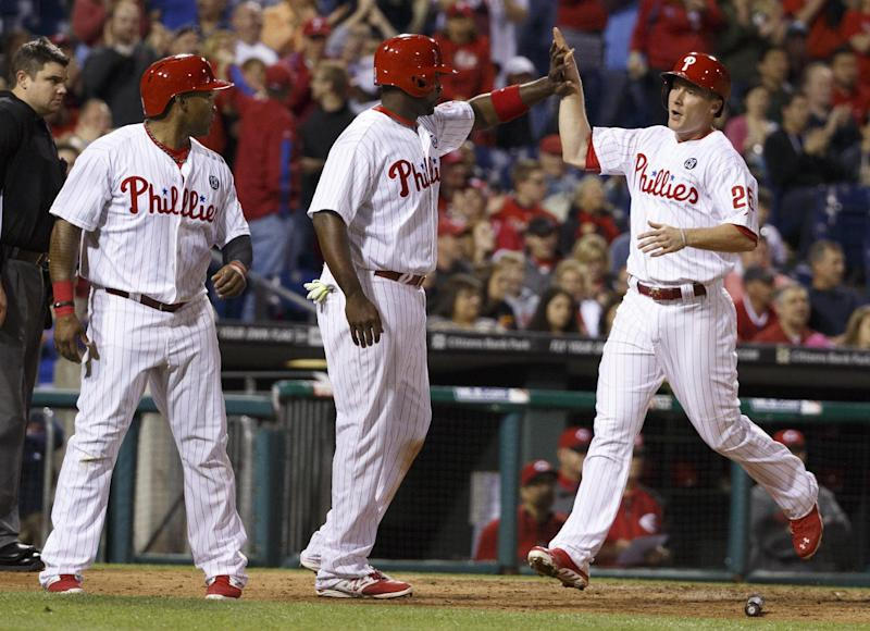 Phillies beat Reds 8-3 behind 4 home runs