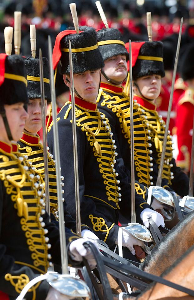 LONDON, ENGLAND - JUNE 15:  Members of the Household Cavalry Mounted Regiment take part in the annual Trooping the Colour Ceremony at Horse guards parade on June 15, 2013 in London, England. Today's ceremony which marks the Queens official birthday will not be attended by Prince Philip the Duke of Edinburgh as he recuperates from abdominal surgery and will also be The Duchess of Cambridge's last public engagement before her baby is due to be born next month.  (Photo by Bethany Clarke/Getty Images)