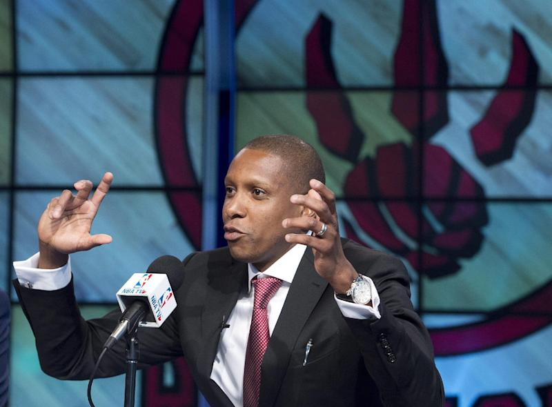 In this June 4, 2013, file photo, Toronto Raptors new general manager Masai Ujiri gestures during an NBA basketball news conference in Toronto. Raptors general manager Ujiri let loose a profanity during a pregame address meant to pump up a group of Raptors fans outside Air Canada Centre before a Saturday, April 19, 2014, opening game of the NBA playoffs