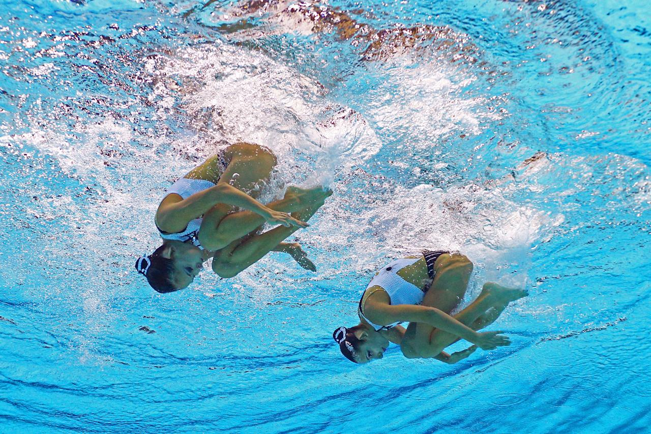 Anna Kulkina and Aigerim Zhexembinova of Kazakhstan compete in the Women's Duets Synchronised Swimming Free Routine Preliminary on Day 10 of the London 2012 Olympic Games at the Aquatics Centre on August 6, 2012 in London, England.  (Photo by Clive Rose/Getty Images)