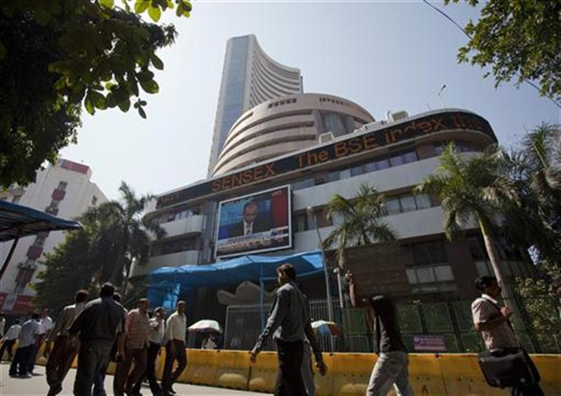 People walk outside the Mumbai Stock Exchange building