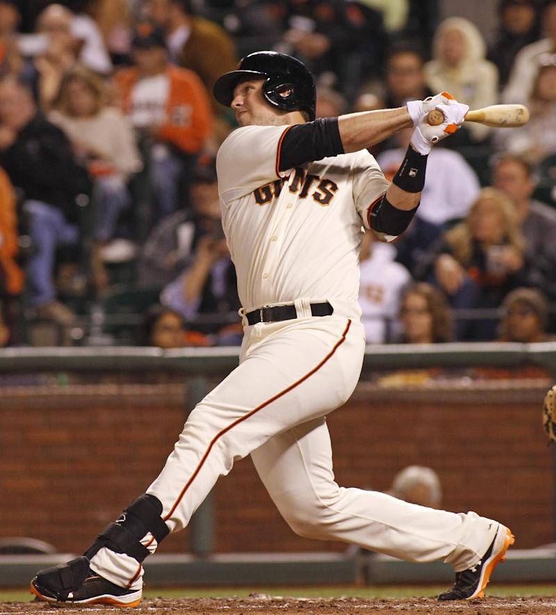 Giants rally to give Cain 1st win