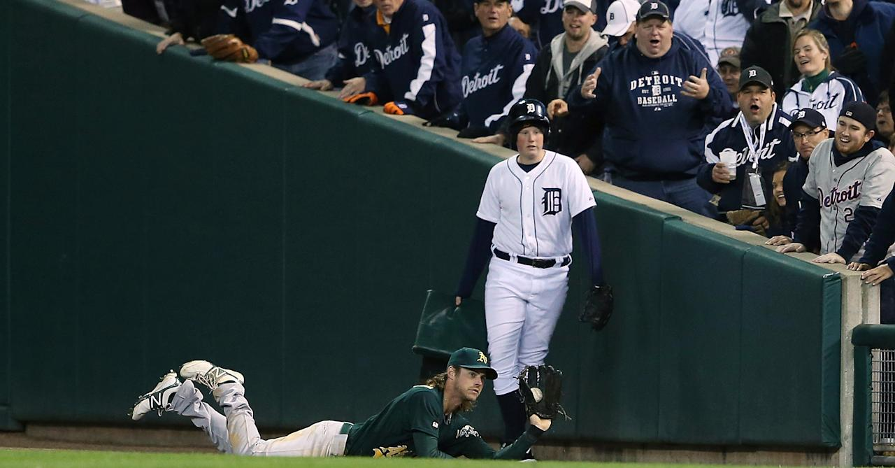 DETROIT, MI - OCTOBER 06:  Josh Reddick #16 of the Oakland Athletics dives and makes the catch on the line drive from Austin Jackson #14 of the Detroit Tigers during the fifth inning of Game One of the American League Division Series against the Detroit Tigers at Comerica Park on October 6, 2012 in Detroit, Michigan. The Tigers defeated the Athletics 3-1.  (Photo by Leon Halip/Getty Images)