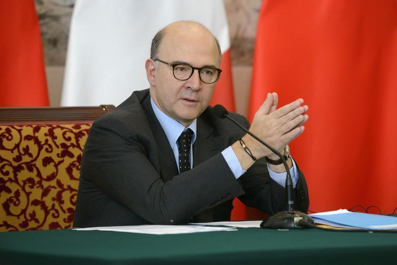 Moscovici attends a news conference in Beijing