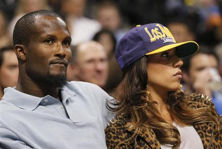 Denver Broncos cornerback Champ Bailey watches the Denver Nuggets play the Los Angeles Lakers with an unidentified woman in Game 4 of their NBA Western Conference basketball playoffs in Denver