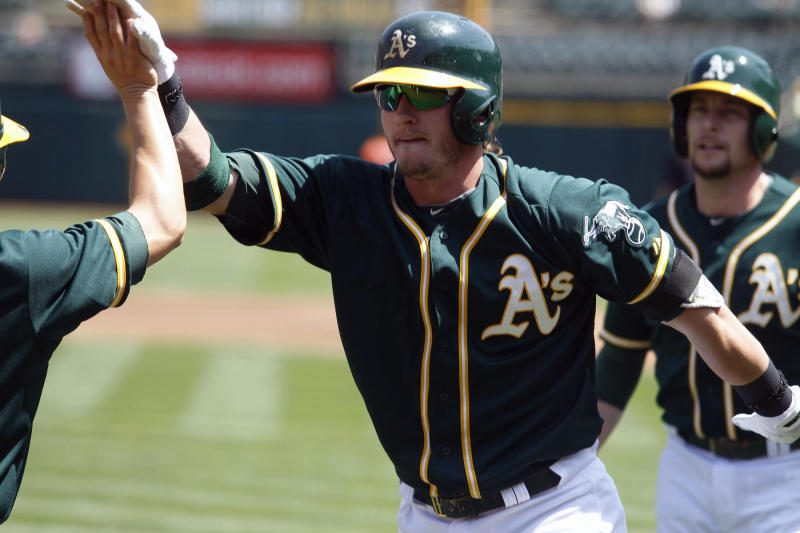 Chavez gets 1st win, A's complete sweep of Astros