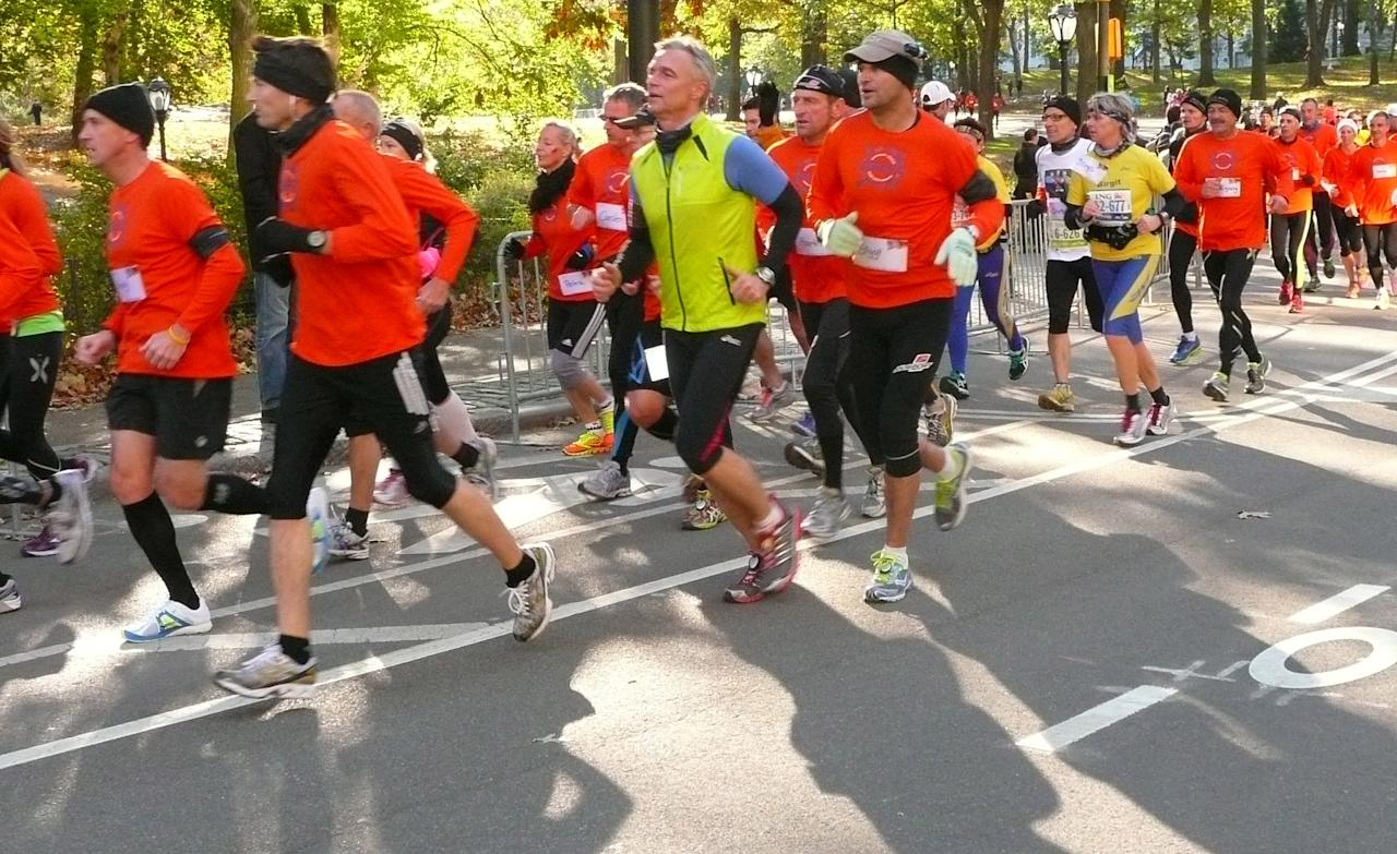Runners who were planning to run in the New York City Marathon run through Central Park in Manhattan in an alternative marathon in New York, Sunday, Nov. 4, 2012. The official race was canceled because of Superstorm Sandy. (AP Photo/Cara Anna)