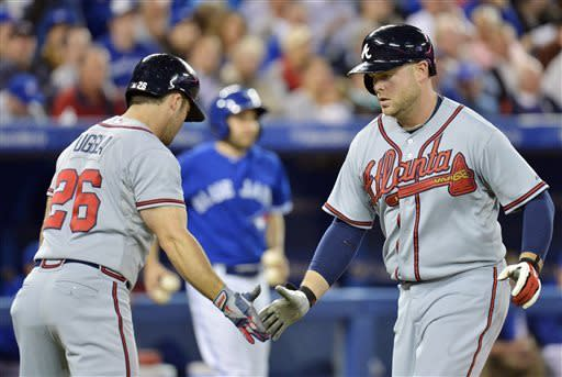 McCann's 2 HRs, shot in 10th gets Braves over Jays