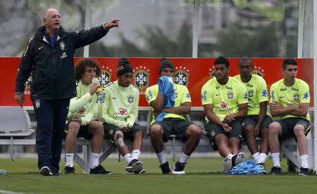 Brazil's national soccer team coach and players attend a training session in Teresopolis