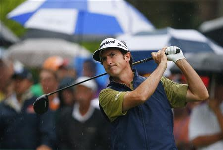 Spain's Gonzalo Fernandez-Castano tees off on the 10th hole during the second round of the 2013 PGA Championship golf tournament at Oak Hill Country Club in Rochester