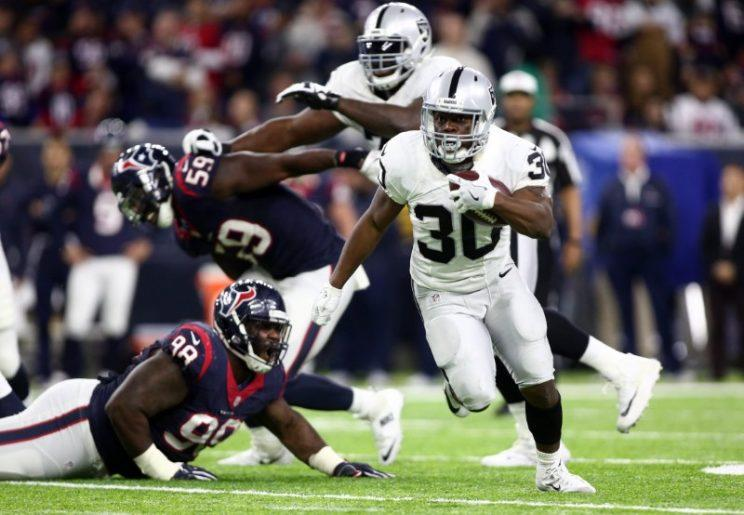 Oakland Raiders defensive back SaQwan Edwards (30) runs the ball during the fourth quarter of the AFC Wild Card playoff football game against the Houston Texans at NRG Stadium. Mandatory Credit: Troy Taormina-USA TODAY Sports