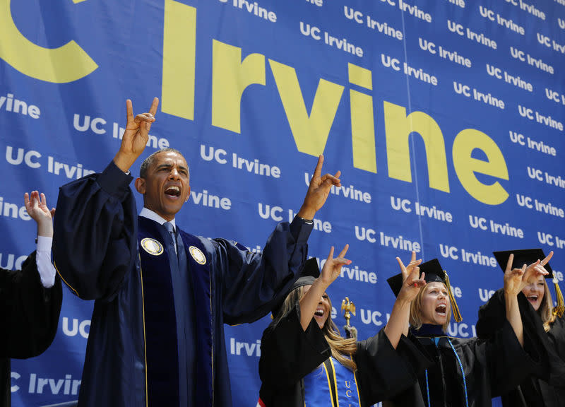 U.S. President Barack Obama yells to honor the school mascot during the commencement ceremony for the University of California, Irvine in Anaheim