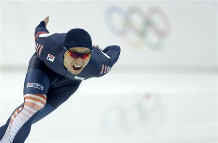 Lee Kyou-hyuk of South Korea competes in the men's 1,000 meters speed skating race during the 2014 Sochi Winter Olympics