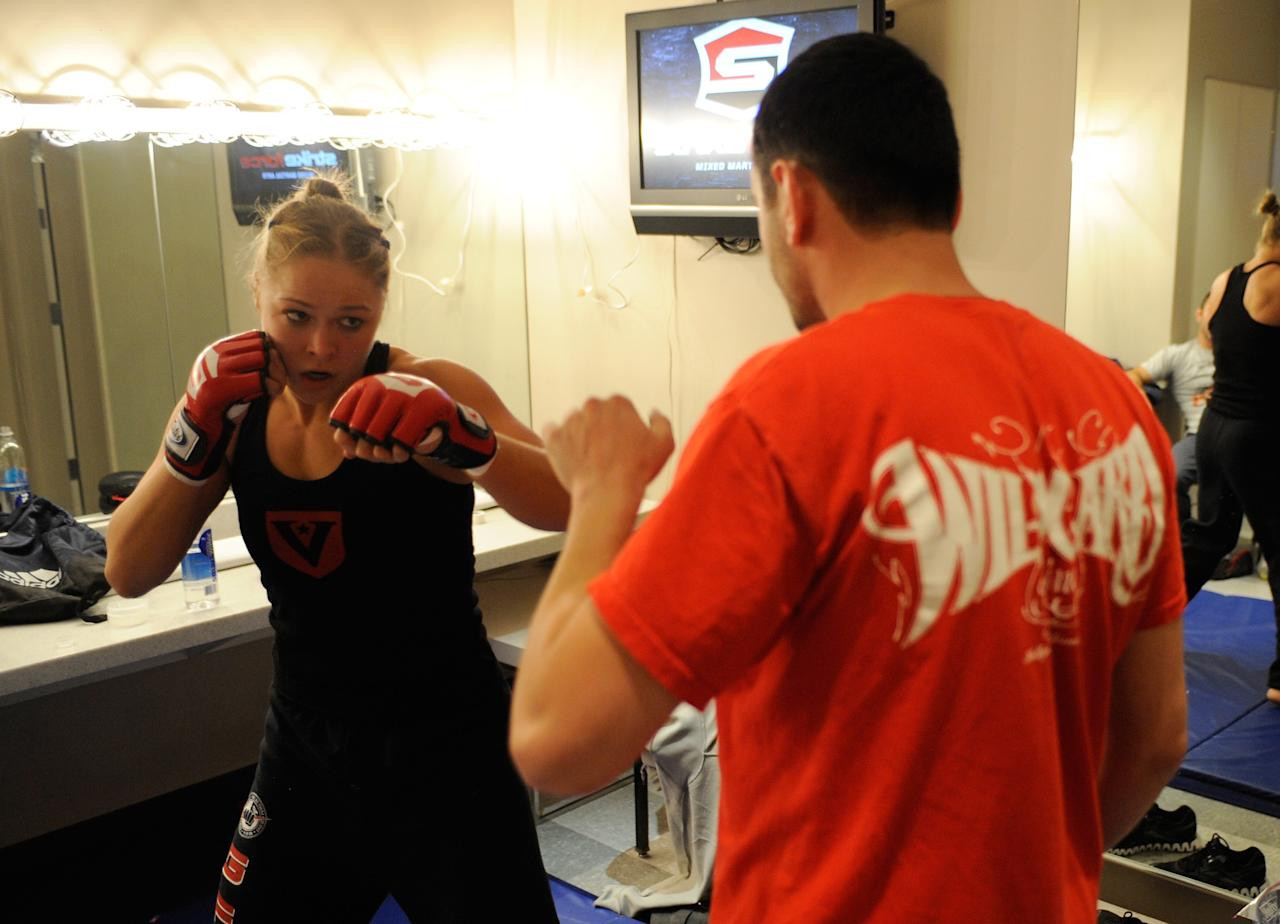 LAS VEGAS - NOVEMBER 18:  Ronda Rousey warms up before her fight with Julia Budd backstage at the Pearl at the Palms on November 18, 2011 in Las Vegas, Nevada.  (Photo by Todd Lussier/Forza LLC/Forza LLC via Getty Images)