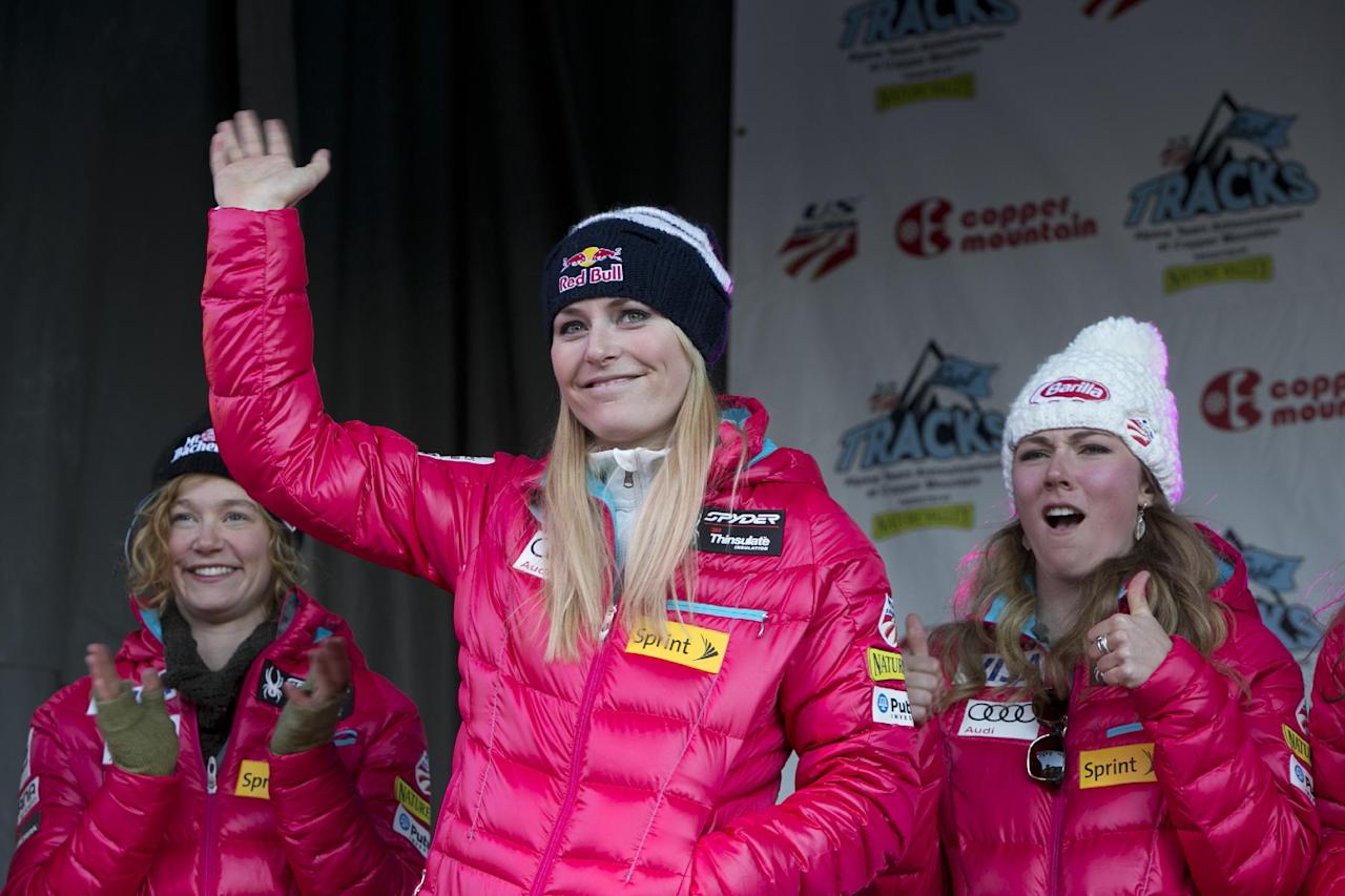 Lindsey Vonn, center, waves to the crowd at a US Ski Team gathering at Copper Mountain, Colo. Friday, Nov. 8, 2013. (AP Photo/Nathan Bilow)