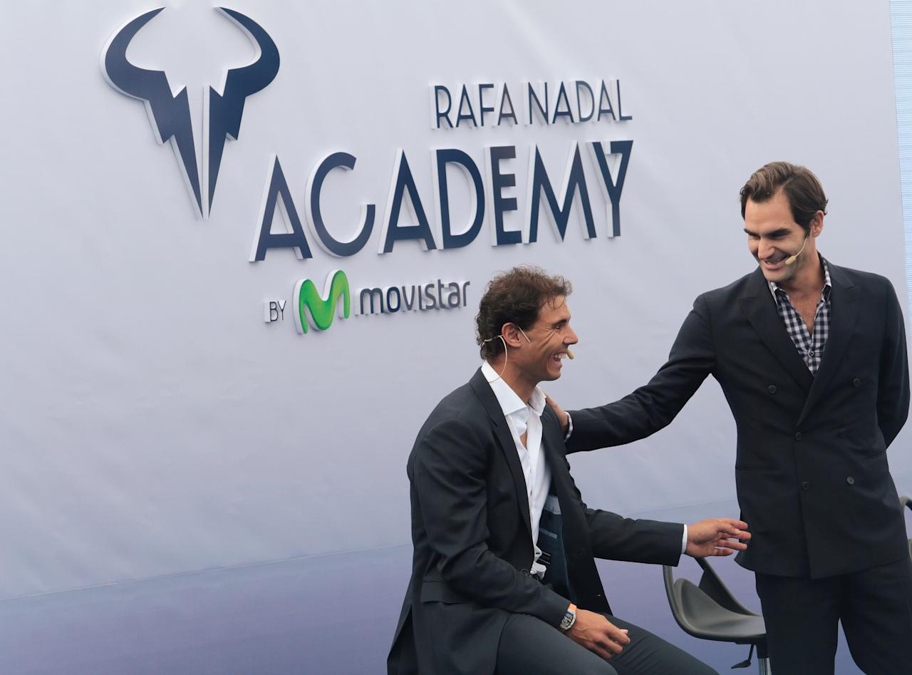 Switzerland's Roger Federer talks to Spain's Rafael Nadal during the opening ceremony of the Rafa Nadal tennis academy in Manacor, Spain, October 19, 2016. REUTERS/Enrique Calvo