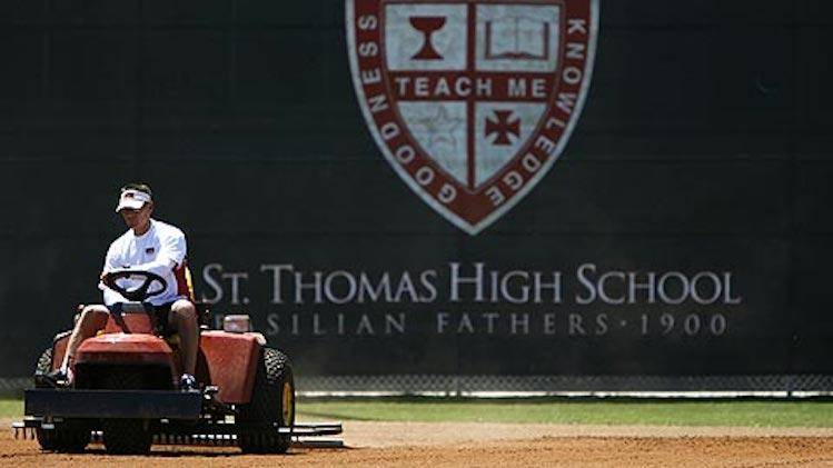Craig Biggio mows the lawn at Houston's Saint Thomas High, where he coached for five seasons -- MLB.com