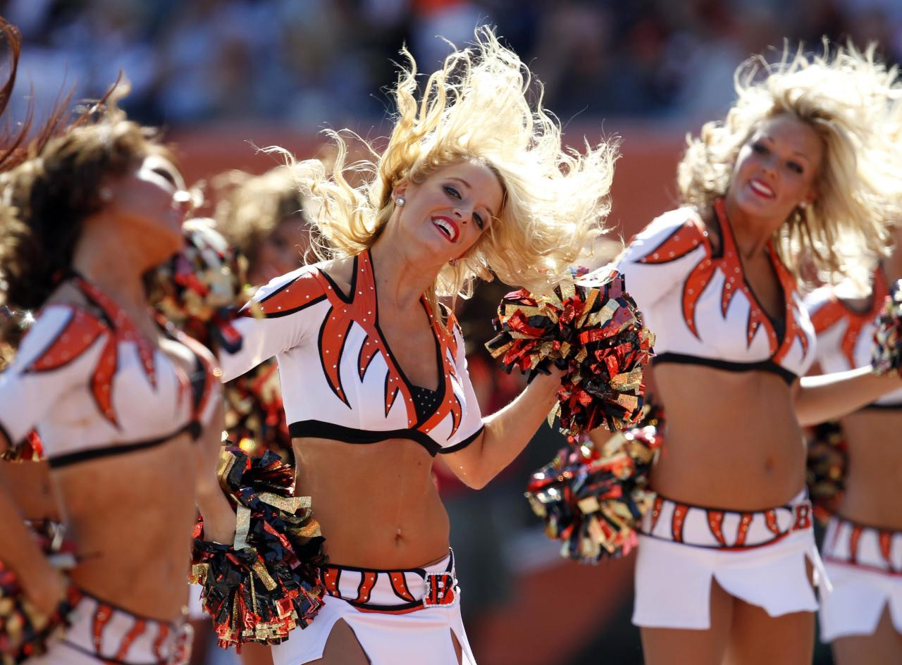 Cincinnati Bengals cheer leaders cheer for their team against the Green Bay Packers in their NFL football game at Paul Brown Stadium in Cincinnati, Ohio, September 22, 2013. REUTERS/John Sommers II (UNITED STATES - Tags: SPORT FOOTBALL)