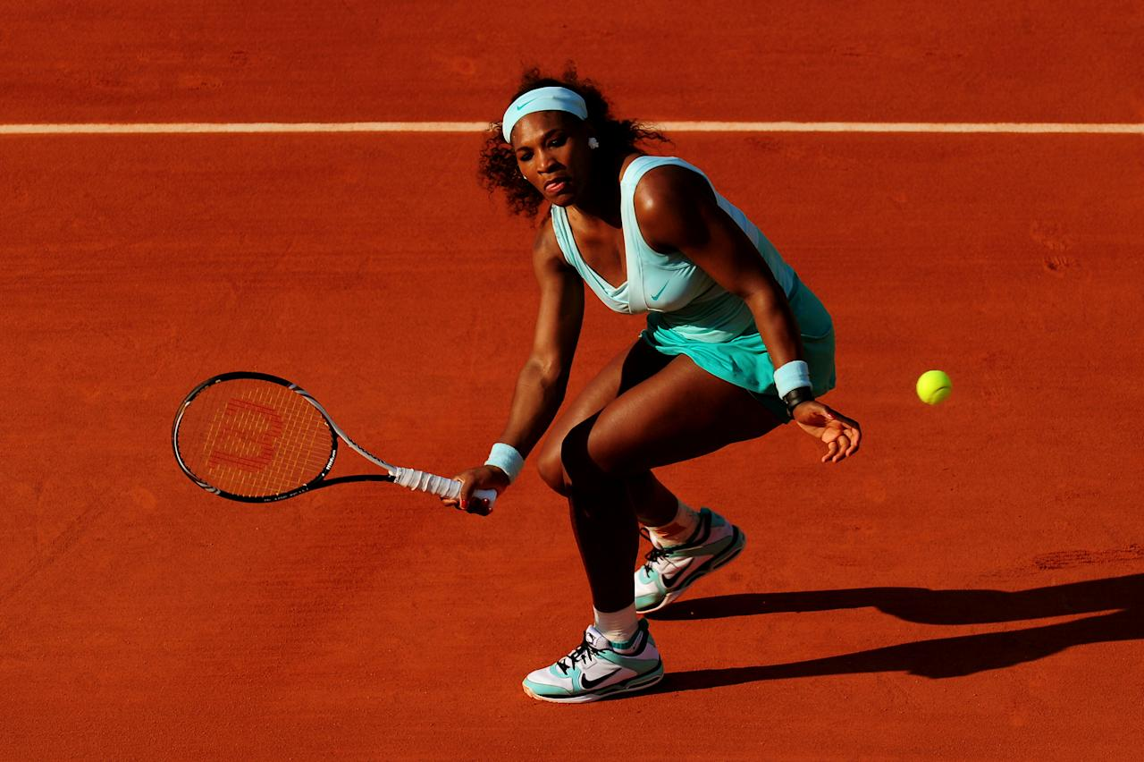 PARIS, FRANCE - MAY 29:  Serena Williams of USA plays a forehand in her women's singles first round match between Serena Williams of USA and Virginie Razzano of France during day three of the French Open at Roland Garros on May 29, 2012 in Paris, France.  (Photo by Mike Hewitt/Getty Images)